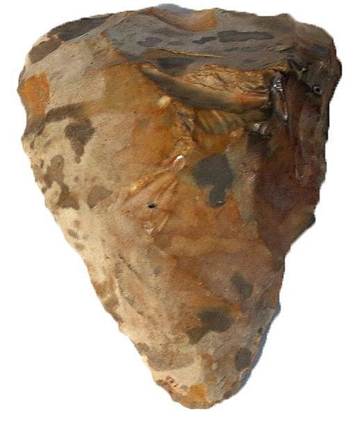 A PREHISTORIC FLINT HAND-AXE Paleolithic Period, ca. 300-200,000 years BP.  12.3 cm high. Very