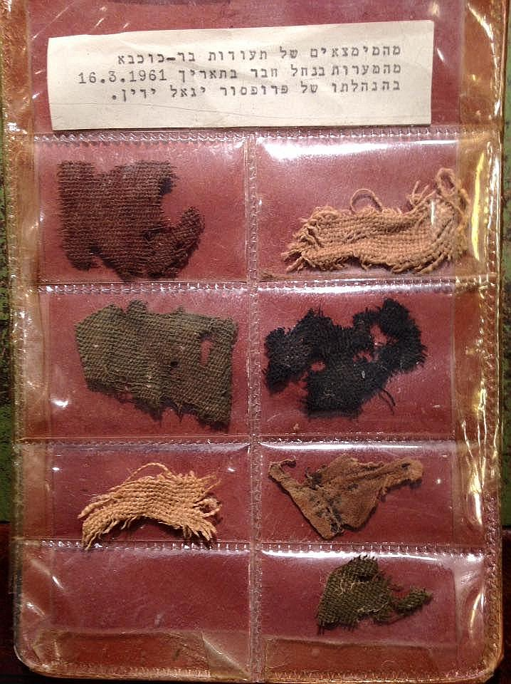 SIX SMALL TEXTILE FRAGMENTS AND A SKIN? FRAGMENT   1st-2nd century CE. One is colored in black, two