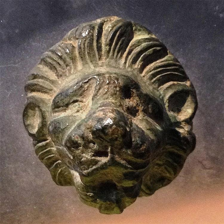 A BRONZE LION HEAD Roman Period, 2nd-4th century CE. Probably the terminal of a handle. With ni