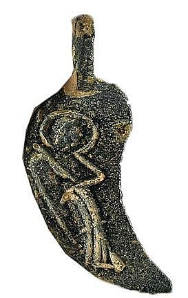 A BYZANTINE BRONZE PENDANT 4th-7th century CE. In the form of an angel's wing, depicting an angel. W