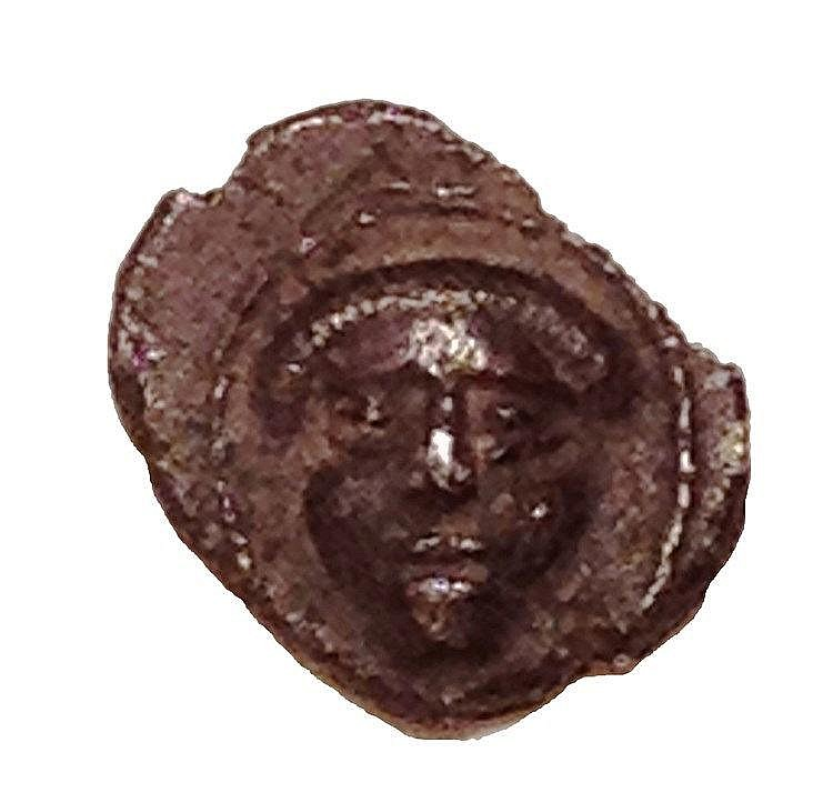 YEHUD, HEZEKIAH THE GOVERNOR 4th century BCE. Silver half obol, 0.2 gr. Obverse: Facing human head.