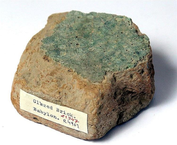 A BABYLONIAN LIGHT-GREEN GLAZED BRICK FRAGMENT 6th century BCE. Originally used in the external