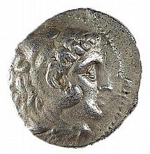 ALEXANDER THE GREAT, 336 – 323 BCE Silver tetradrachm, 17.2 gr. Obverse: Head of Herakles with