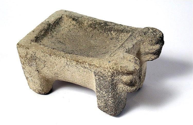 A HITTITE BASALT CULTIC BULL ALTAR Early 1st millennium BCE. 18.5 cm in length. With four legs