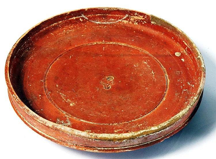 A RED TERRA-SIGILATA PLATE Roman Period, 1st-4th century CE. With a floral seal impression in t