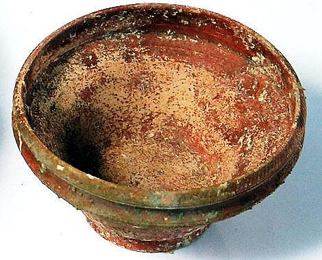 A SMALL RED TERRA-SIGILATA BOWL Roman Period, 1st-4th century CE. With linear decoration on the
