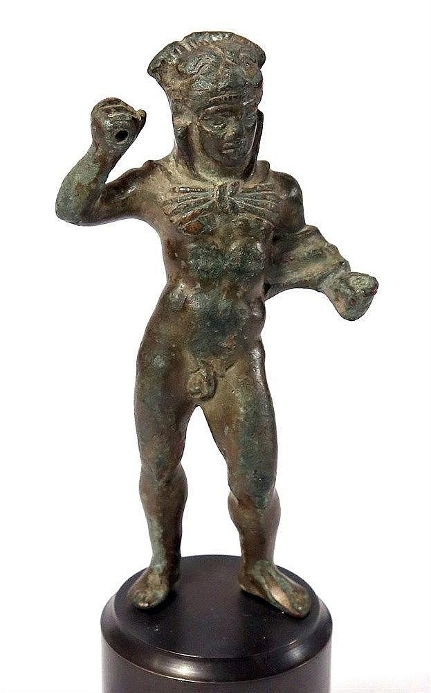 AN ETRUSCAN BRONZE STATUETTE OF HERCULES 4th-3rd century BCE. The Hero is depicted naked in a f
