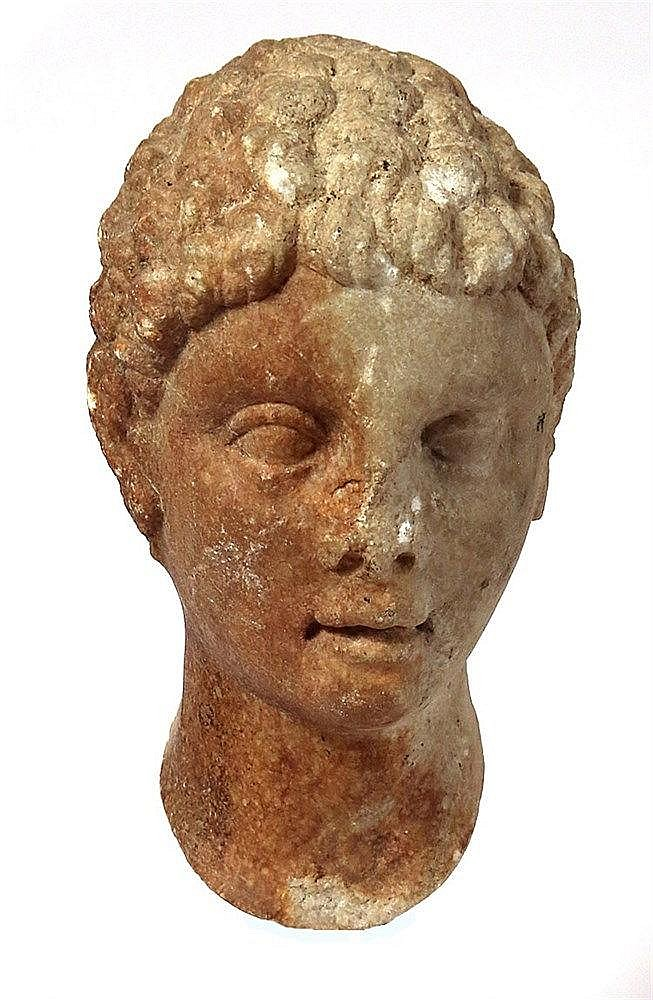 A ROMAN MARBLE HEAD OF A YOUTH 1st or 2nd century CE. The head, which was originally inserted in a b