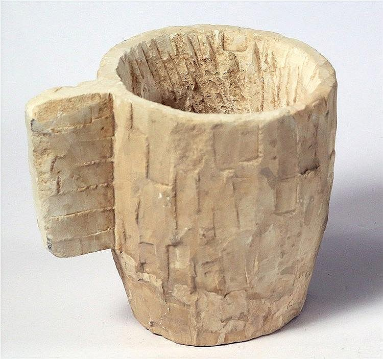 AN UNFINISHED LIMESTONE MUG Roman Period, 1st century CE. 1st cm high. Base mended but in fair