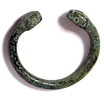 A BRONZE BRACELET WITH TWO SNAKE HEADS Luristan, 8th-7th century BCE. With nice green patina an