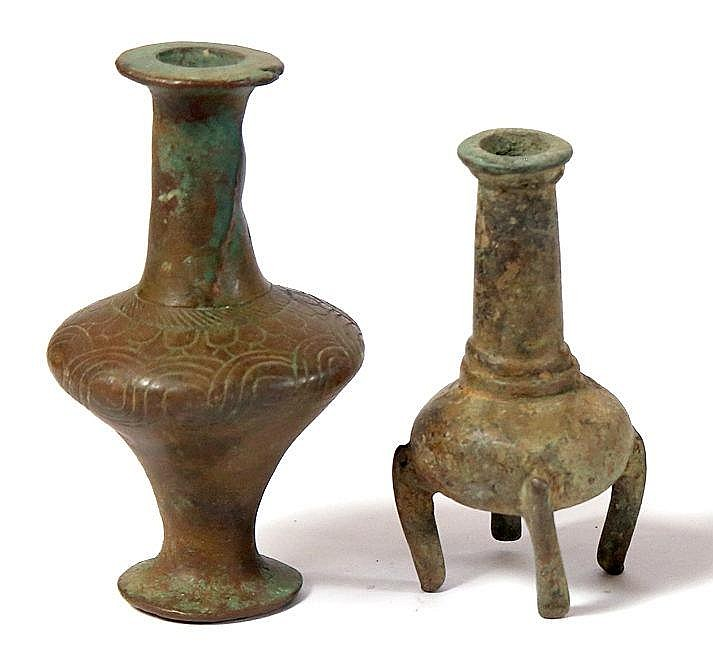 TWO BRONZE COSMETIC BOTTLES 2nd millennium BCE. One decorated around the shoulders, slightly damaged