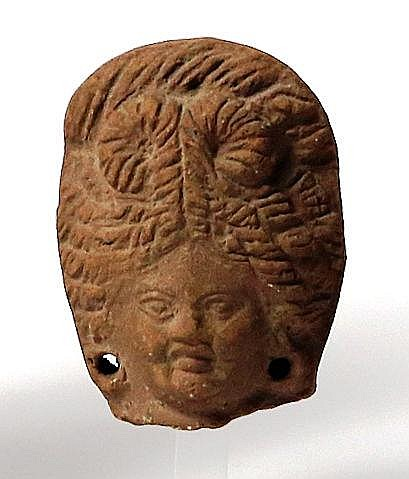 A TERRACOTTA HEAD OF A LADY Roman Period in Fayum, 1st century BCE-CE. In very good condition.