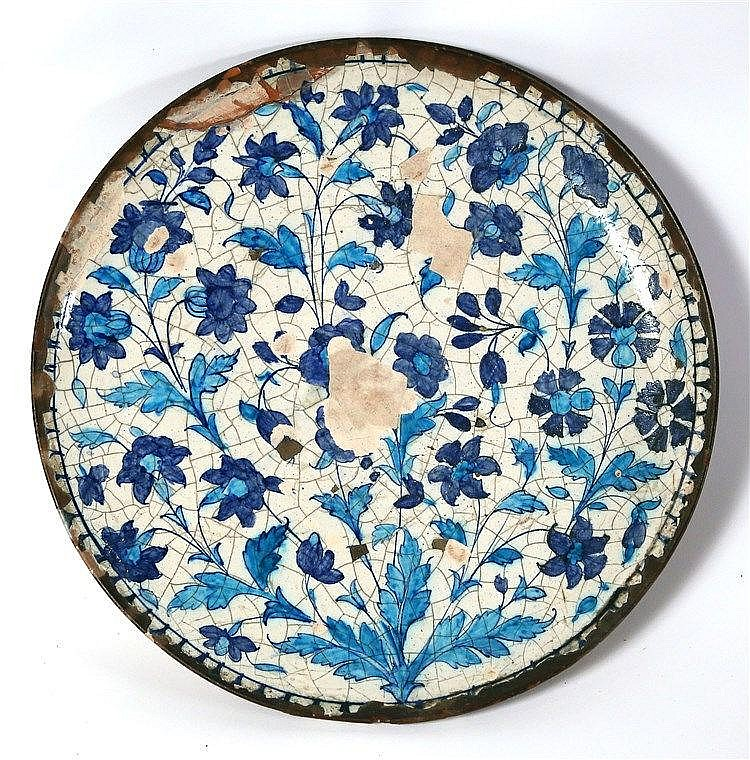 A GLAZED TERRACOTTA DISH 18th-19th century CE. Depicting a floral pattern in pale and dark blue col