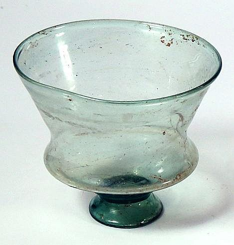 A TRANSLUCENT PALE GREEN GLASS CARRINATED CHALICE 5th century CE. With flaring rim and stemmed