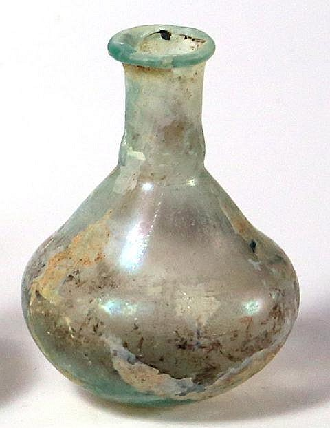 A TRANSLUCENT GLASS JUGLET 1st-2nd century CE. With pear-shaped body and cylindrical neck. In very g
