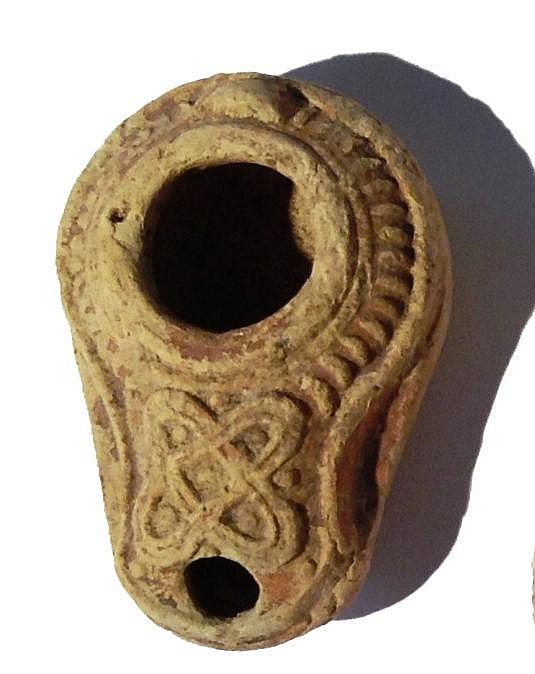 A BEIT-NATIF TYPE CLAY OIL LAMP 4th century CE. Decorated with geometrical motif. In good condition
