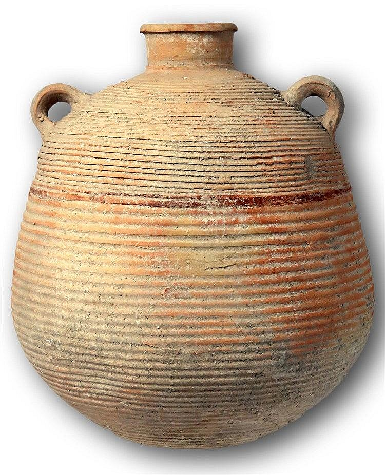 ROMAN TERRACOTTA STORAGE JAR 1st-2nd century CE. Decorated with a red line around the body. In very