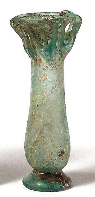A TRANSLUCENT GLASS FLASK WITH ZIGZAG DECORATION AROUND THE NECK Roman Period, 4th century CE.