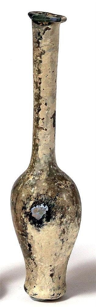 A COSMETIC GLASS BOTTLE 1st-2nd century CE. With inverted pear-shaped body and cylindrical neck. In