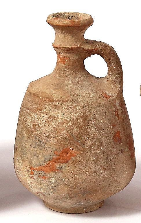 A JUDAHITE CERAMIC WINE DECANTER Iron Age II, 8th-7th century BCE. Repaired. 20 cm high. Ex Reu