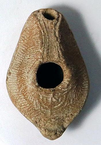 A TERRACOTTA OIL LAMP DEPICTING A MENORAH WITH 7 BRANCHES Byzantine Period, 4th-6th century CE.