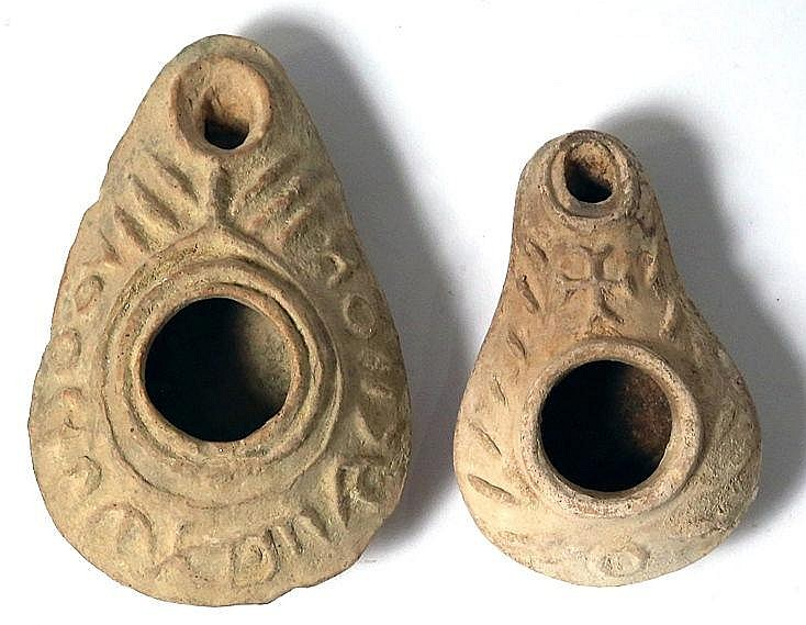 A LOT OF 2 CHRISTIAN TERRACOTTA OIL LAMPS Byzantine Period, 5th-7th century CE. One decorated w