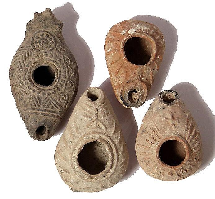 A LOT OF 4 TERRACOTTA OIL LAMPS Byzantine Period, 4th-7th century CE. Two decorated with a cros