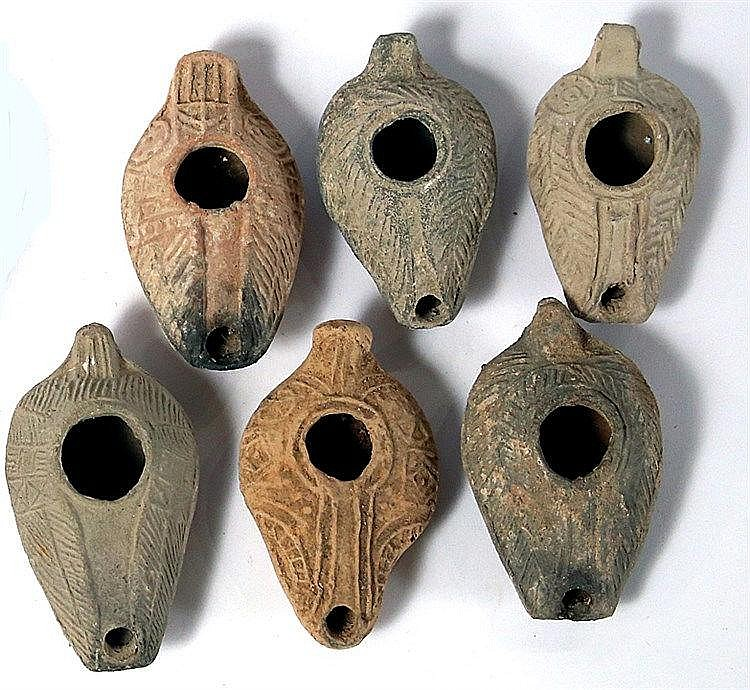 A LOT OF 6 SAMARITAN TERRACOTTA OIL LAMPS Byzantine Period, 4th-7th century CE. Decorated with