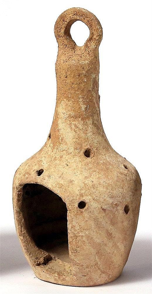A BYZANTINE TERRACOTTA LANTERN  4th-7th century CE. Body perforated and with high hanging handle. In