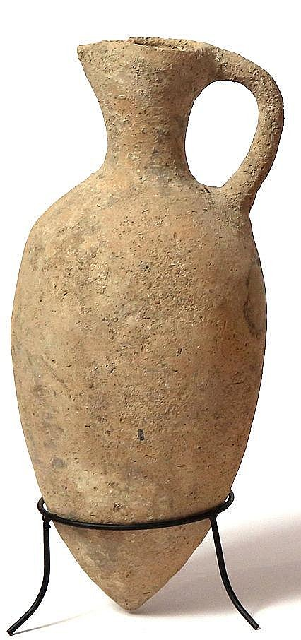 A CANAANITE TERRACOTTA JUGLET Middle Bronze Age 1830 – 1550 BCE. A small hole under the handle