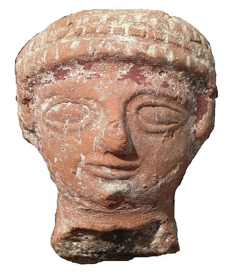 THE HEAD OF A TERRACOTTA JUDAHITE PILLAR FIGURINE MADE IN A MOLD 8th-7th century BCE. With traces of