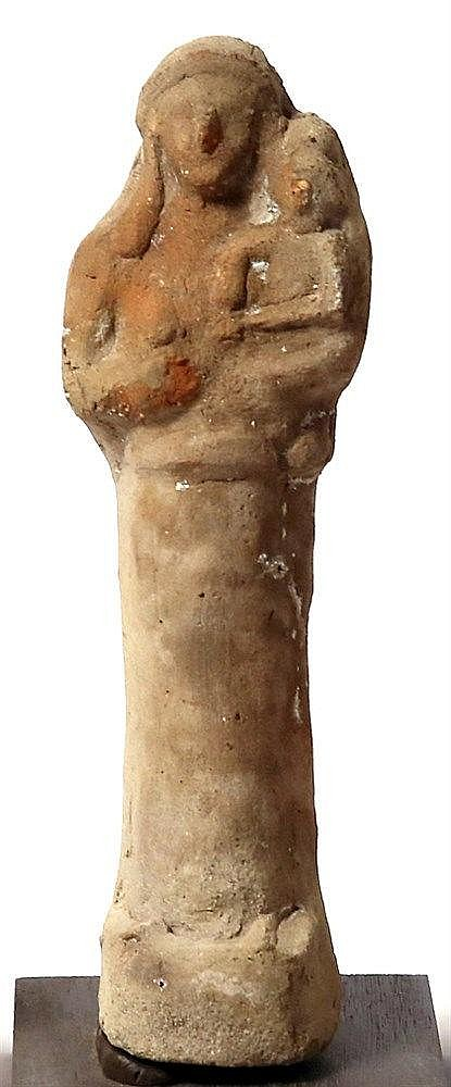 A TERRACOTTA FIGURINE OF A WOMAN HOLDING A CHILD Persian Period, 5th-4th century BCE. 18.5 cm h