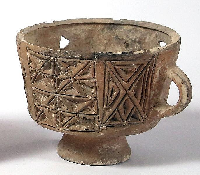 A BYZANTINE CERAMIC INCENSE BURNER 4th-7th century CE. With geometric decorations. In very good