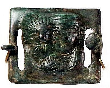 A BRONZE BUCKLE 3rd-7th century CE. Depicting an adoring couple in a window. With nice green patina.