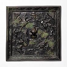 A BRONZE MIRROR WITH A HUNTING SCENE