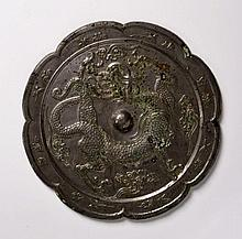 A BRONZE MIRROR WITH A DRAGON