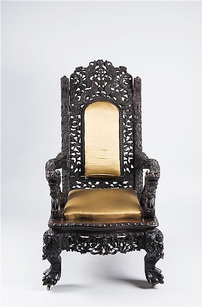 A DECORATIVE HARDWOOD ARMCHAIR
