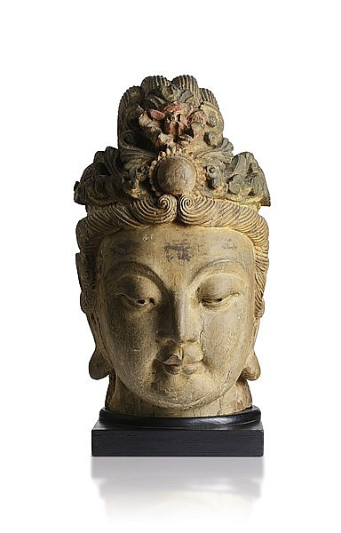A RARE CARVED WOOD HEAD OF GUANYIN