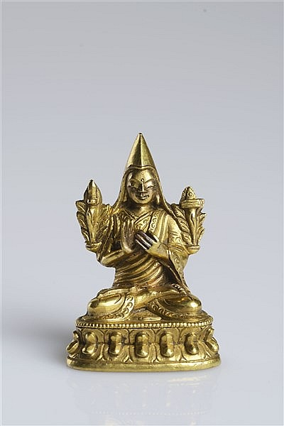 A MINIATURE GILT BRONZE FIGURE OF TSONGKHAPA