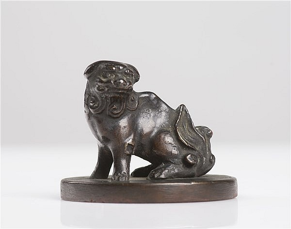 A BRONZE SEAL IN THE SHAPE OF A LION