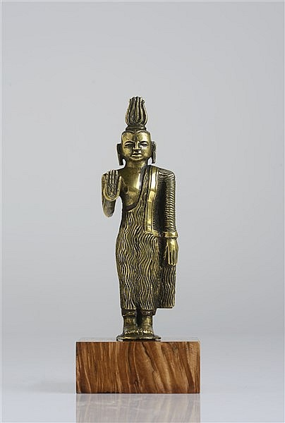 A SOLID CAST GILT BRONZE FIGURE OF BUDDHA