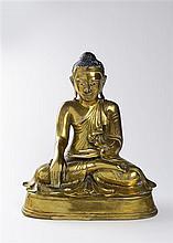 A GILT BRONZE FIGURE OF BUDDHA SHAKYAMUNI