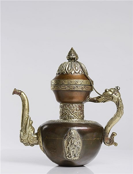 A COPPER AND SILVER TEAPOT
