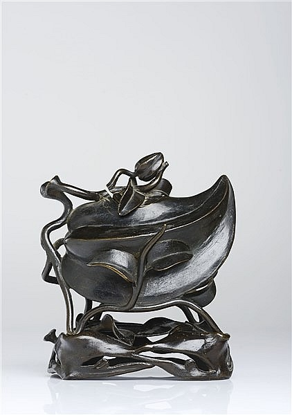 A PHYSALIS-SHAPED BRONZE CENSER AND COVER