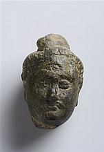 A GRAY SCHIST HEAD OF A BUDDHA