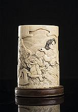 A SMALL CARVED IVORY ASHTRAY