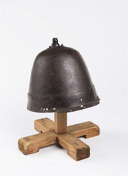 A MILITARY IRON HELMET