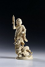 AN IVORY OKIMONO OF AN ARHAT WITH A DRAGON