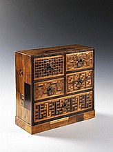 A PARQUETRY MINIATURE CHEST OF DRAWERS