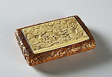 A FINELY CARVED BOXWOOD AND IVORY CIGARETTE CASE